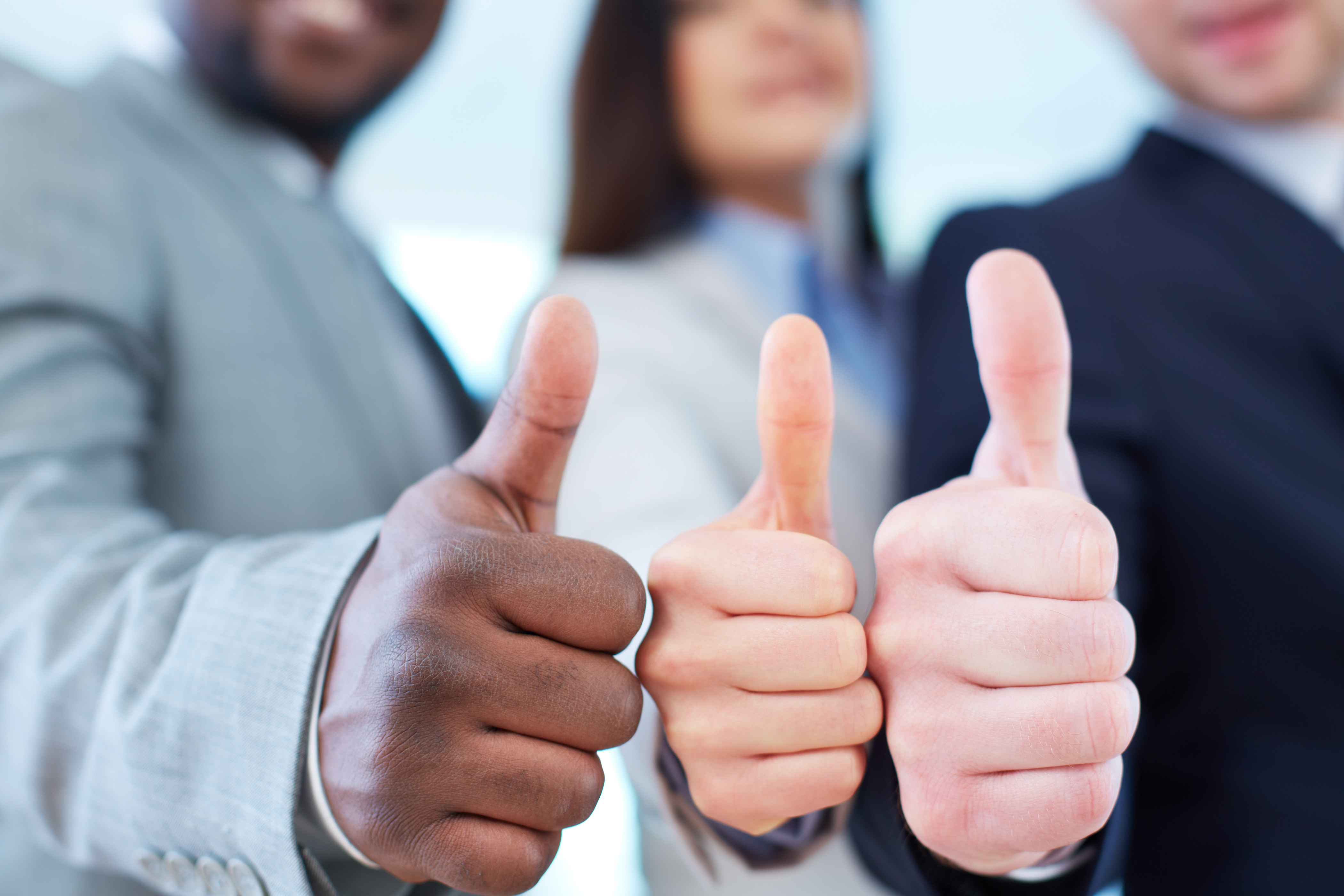 Business partners keeping thumbs up