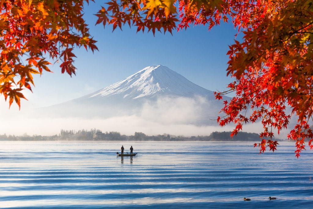 Mountain Fuji and lake with morning fog in autumn season