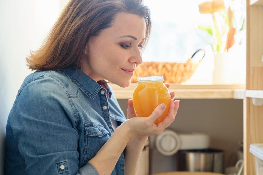 Jar of golden organic fresh honey